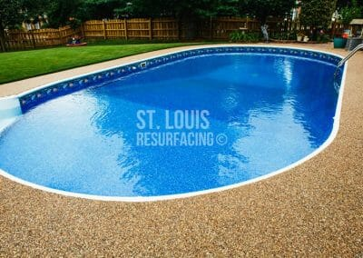 pebble-stone epoxy pool deck in st. louis, missouri installed by St. Louis Resurfacing