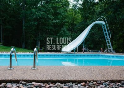 pebble-stone epoxy pool deck in st. louis, Missouri