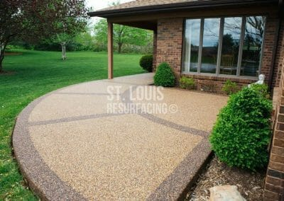 pebble-stone epoxy patio in Missouri installed by local St. Louis Resurfacing, Inc. Decorative concrete resurfacing was performed.