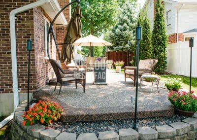 pebble-stone epoxy patio, walkway in Missouri installed by local St. Louis Resurfacing, Inc. Decorative concrete resurfacing was performed.