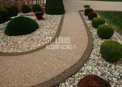 pebble-stone epoxy sidewalk, walkway in Missouri installed by local St. Louis Resurfacing, Inc. Decorative concrete resurfacing was performed.
