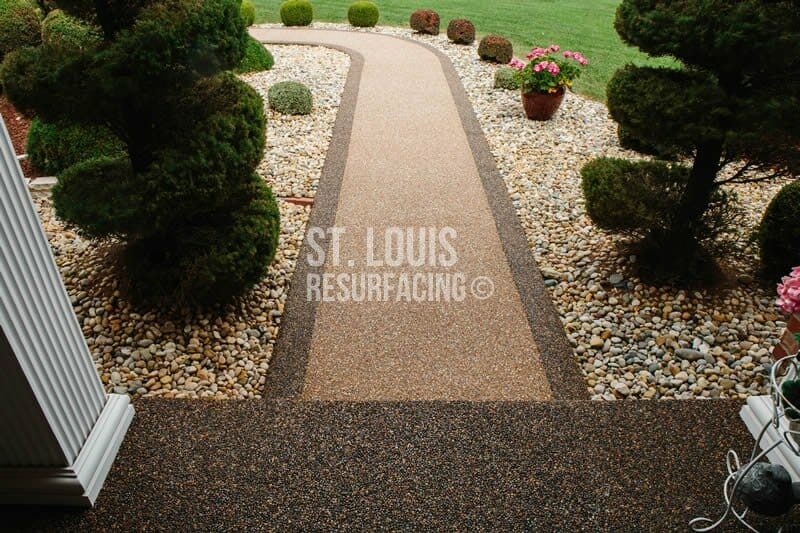 Pebble-stone epoxy flooring for front porch and sidewalk by St. Louis Resurfacing in St. Charles, Missouri. Decorative Concrete Resurfacing with border