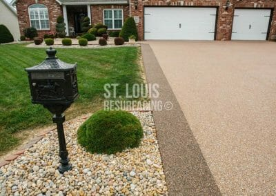 pebble-stone epoxy driveway in Missouri installed by local St. Louis Resurfacing, Inc. Decorative concrete resurfacing was performed.