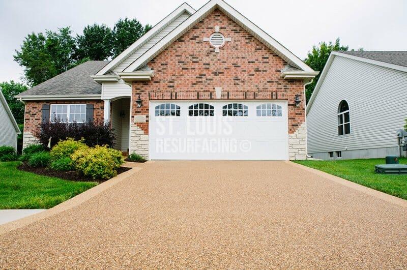 Pebble-stone epoxy driveway by St. Louis Resurfacing