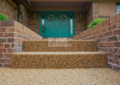 pebble-stone epoxy porch in Missouri installed by local St. Louis Resurfacing, Inc. Decorative concrete resurfacing was performed.
